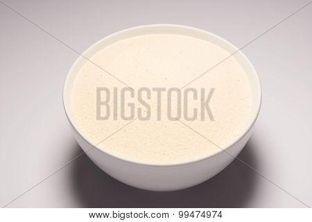 Semolina croup in white ceramic bowl