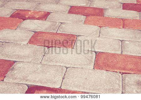 Red brick stone street road. Light sidewalk, pavement texture