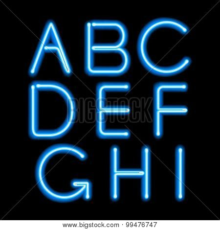 Blue neon light glowing letters set.