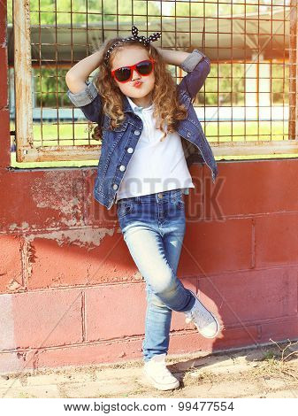 Fashion Kid Concept - Stylish Little Girl Child Wearing A Jeans Clothes And Sunglasses Posing Summer