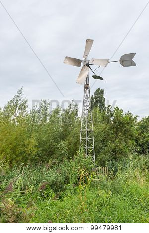 Fully Automatic Metal Wind Watermill In A Scenic Area