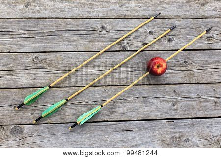 arrow pierced Apple