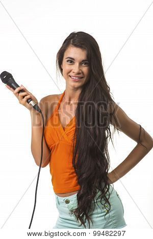 Lovely woman in orange shirt with microphone.