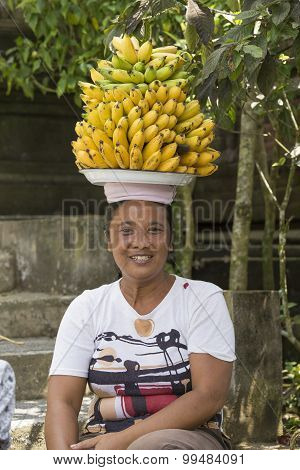 Portrait  Balinese Woman Together With Bananas. Indonesia