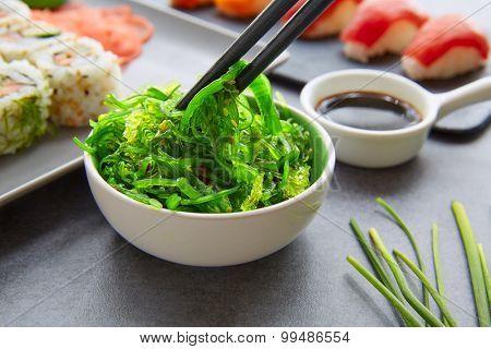 Sushi Maki and Niguiri California roll with seaweed chuka salad soy sauce
