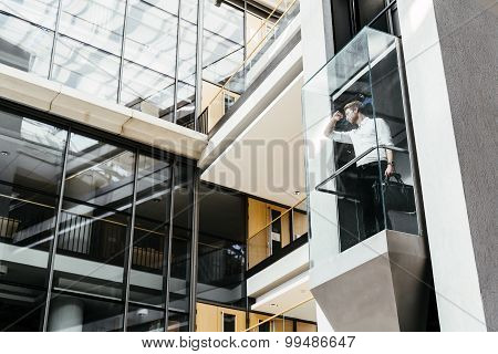 Businessman Taking The Elevator