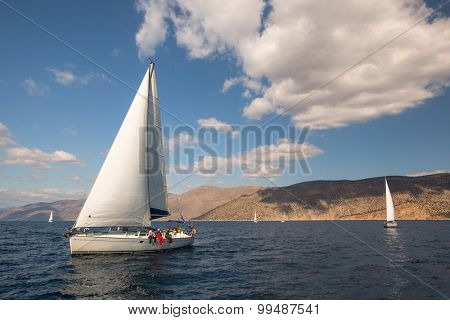 CORINTH - GALAXIDI, GREECE - CIRCA SEP, 2014: Sailboats participate in sailing regatta 12th Ellada Autumn 2014 among Greek island group in the Aegean Sea, in Cyclades and Argo-Saronic Gulf.