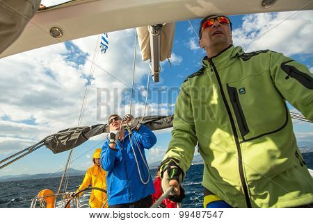 CORINTH - GALAXIDI, GREECE - CIRCA SEP, 2014: Sailors participate in sailing regatta 12th Ellada Autumn 2014 among Greek island group in the Aegean Sea, in Cyclades and Argo-Saronic Gulf.