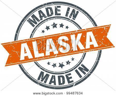 Alaska Orange Grunge Ribbon Stamp On White