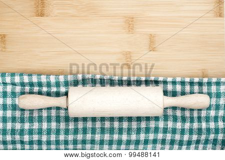 Wooden table covered with tablecloth