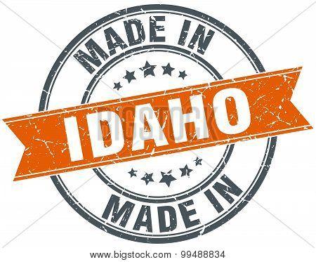 Idaho Orange Grunge Ribbon Stamp On White