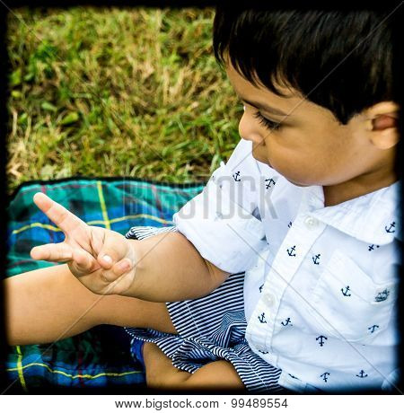 Latino Child Counting On Fingers
