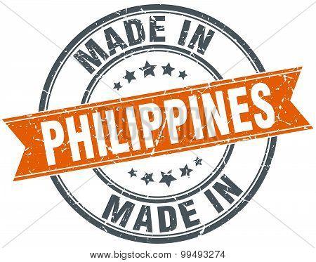 Philippines Orange Grunge Ribbon Stamp On White