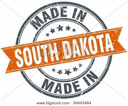South Dakota Orange Grunge Ribbon Stamp On White