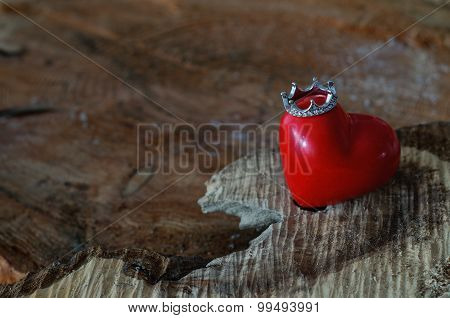 Heart With Crown On Wooden Background