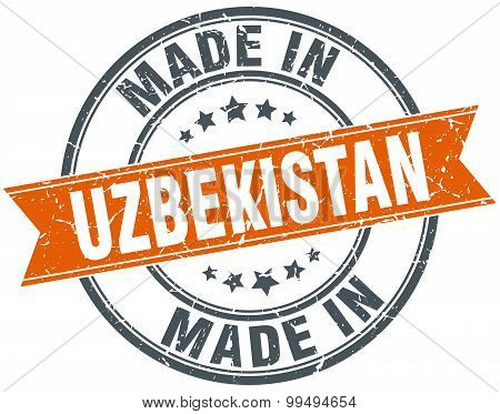 Uzbekistan Orange Grunge Ribbon Stamp On White