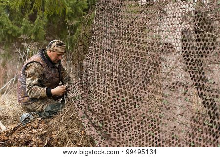 Hunter And Camouflage Netting