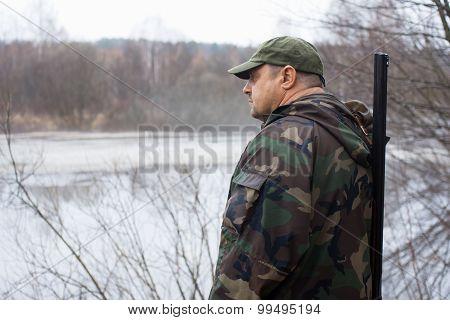 Hunter Near The Lake