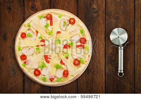 Delicious Pizza With Chicken And Cutter Near