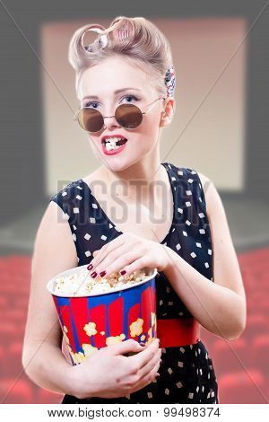 Funny pinup lady in glasses  holding big bowl of popcorn