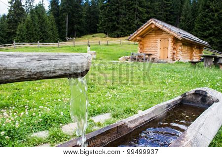 Wooden Trough With Spring Water In  A  Farmhouse