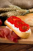 ������, ������: Piece Of Baguette With Fresh Gervais Cream Cheese And Tomatoes