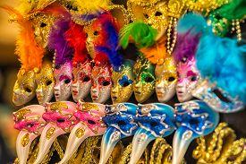 stock photo of venice carnival  - Colorful carnival masks on the market in Venice - JPG