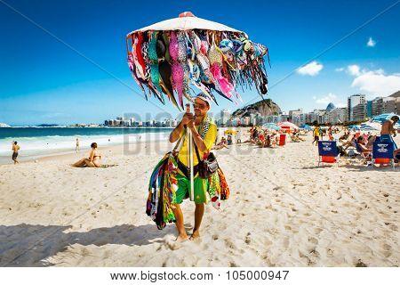RIO DE JANEIRO, BRAZIL - APRIL 28, 2015: Brazilian street vendor sells swimsuit on April 28, 2015 at Copacabana Beach, Rio de Janeiro. Brazil.