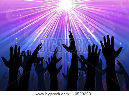 Hands raised from the people with light colourful