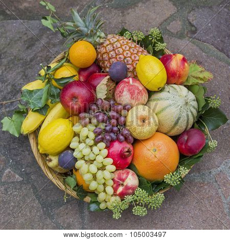 Mixed Fruits In A Rattan Basket, With Ivy Leaves