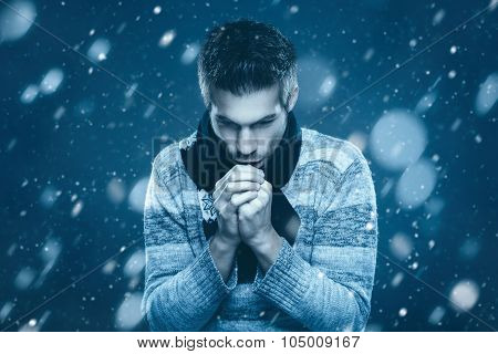 Young Man Is Freezing In The Snow