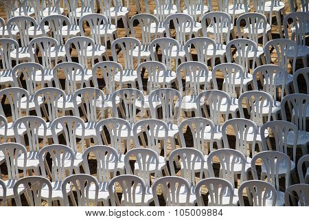 Patter composed by chairs of white plastic