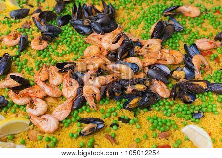 Large Pan Of Paella With Mussels, Prawns; Rice And Peas.