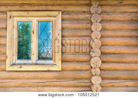Log Wall With A Window