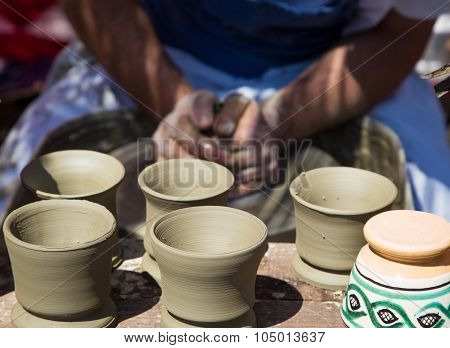 Potter Hands Creating A New Cups
