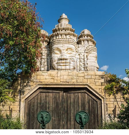 Stone Faces Of A Temple And Wooden Portal.