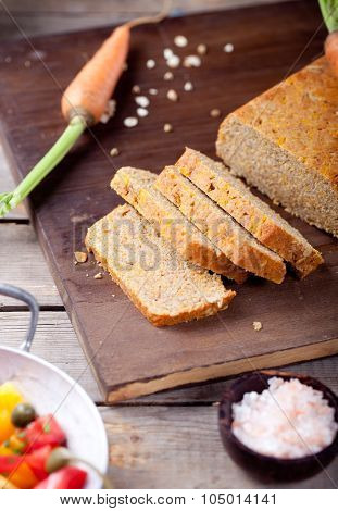 Fresh carrot, spelt and oat bread, loaf