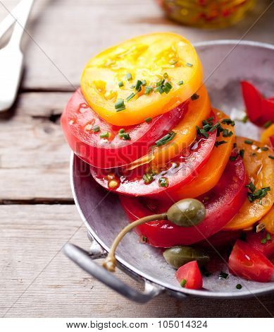 Red and yellow fresh tomato salad with bread