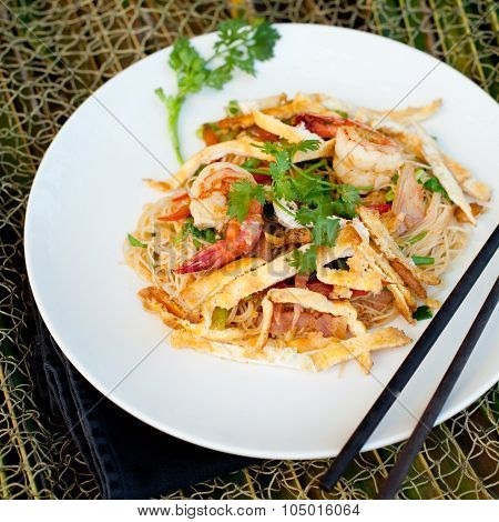 Stir fried noodles with eggs and shrimps