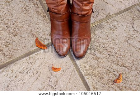 Toes Of Tan Leather Boots On A Concrete