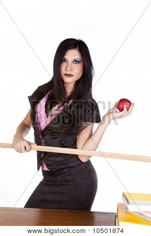 Teacher Behind Desk Ruler Apple Serious