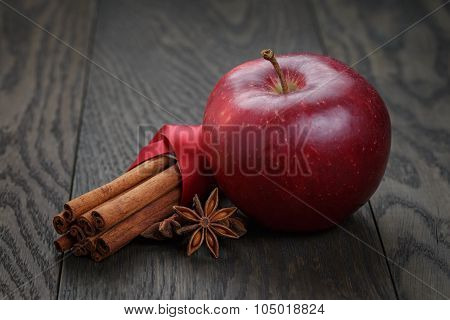 red apple with cinnamon sticks and anise