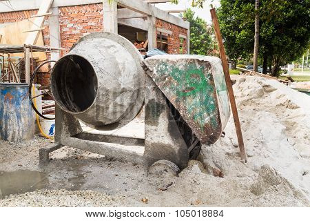 Cement Concrete Mixer With Construction Site In Background