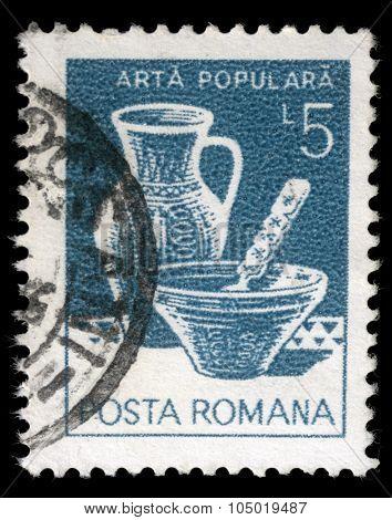 ROMANIA - CIRCA 1982: a stamp printed in Romania shows Folk Art, Plate jug, Varna, circa 1982.