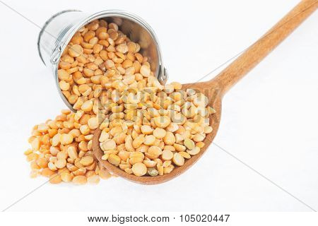 Bucket Of Peas Crumbles In The A Wooden Spoon