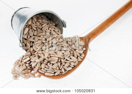 Bucket Of Sunflower Seeds Crumbles In The A Wooden Spoon