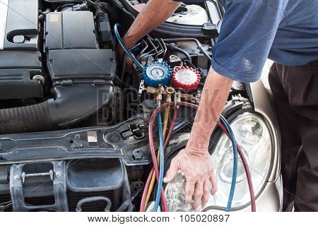 Mechanic With Manometer Inspecting Auto Vehicle Air-condition Compresser With Manometer