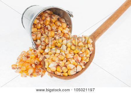 Bucket Of Corn Crumbles In The A Wooden Spoon