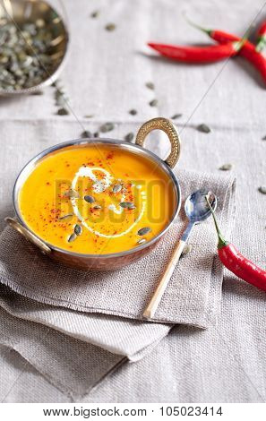 Pumpkin cream-soup with chili and seeds