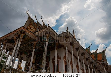 Roof of temple in Laos with blue sky and clouds